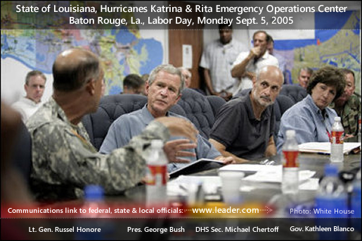 President George W. Bush receives a briefing from U.S. Army Lt. General Russel Honore, left, inside the Emergency Operations Center in Baton Rouge, La., Monday Sept. 5, 2005, as Homeland Security Secretary Michael Chertoff, second from right, and Louisiana Governor Kathleen Blanco, right, participate the meeting. The polycom device on the conference table is linked to Leader Technologies alert, conferencing and document management services employed by federal, state and local officials.