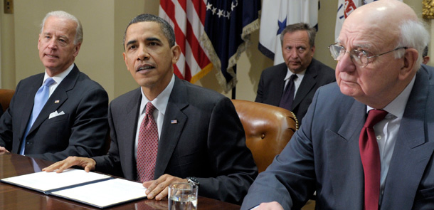 President Barack Obama, flanked by Vice President Joe Biden, Bailout Director Larry Summers (rear), and White House adviser Paul Volcker, speaks during a meeting of the President's Economic Recovery Advisory Board in 2010. Photo Source: Center for American Progress.