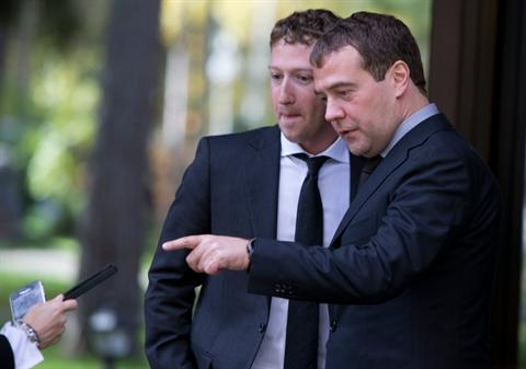 Russian Prime Minister Dmitry Medvedev, right, and Facebook CEO Mark Zuckerberg ask a Kremlin staffer to take a photo of them on their cell phones after the meeting at the Gorki residence outside Moscow, Russia, Monday, Oct. 1, 2012. (AP Photo/Alexander Zemlianichenko)