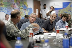 President George W. Bush receives a briefing from U.S. Army Lt. General Russel Honore, left, inside the Emergency Operations Center in Baton Rouge, Louisiana, Monday Sept. 5, 2005, as Homeland Security Secretary Michael Chertoff, second from right, and Louisiana Governor Kathleen Blanco, right, participate the meeting. Photo: White House.